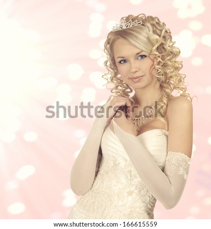Portrait of a beautiful bride on light pink bokeh  background.