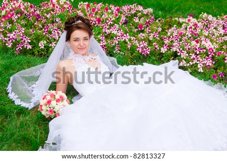 Portrait of a beautiful bride on the grass