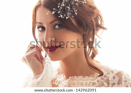 Portrait of a beautiful bride smiling. - stock photo