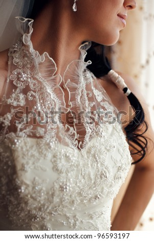 Portrait of a beautiful brides low-necked dress - stock photo