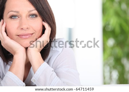 Portrait of a beautiful brown-haired woman - stock photo