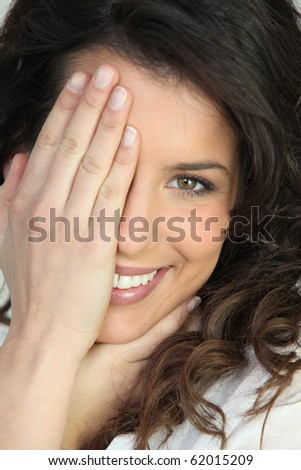 Portrait of a beautiful brown-haired woman smiling