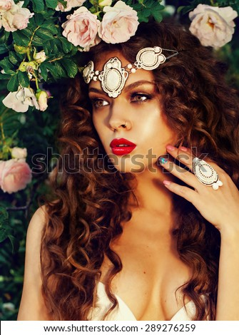 portrait of a beautiful brunet in the summer - stock photo
