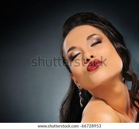Portrait of a beautiful brunette - stock photo