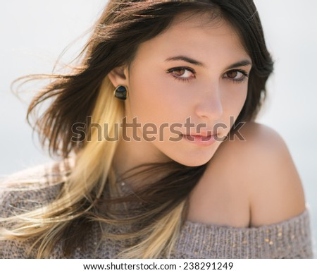 Portrait of a beautiful brunette. Close-up. Shallow depth of field.