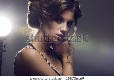 portrait of a beautiful brunette dressed fashionably