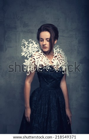 Portrait of a beautiful brunette girl  on grunge  background - stock photo