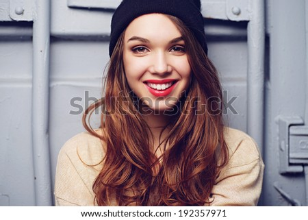 Portrait of a beautiful brunette girl outdoors in hat, lifestyle - stock photo