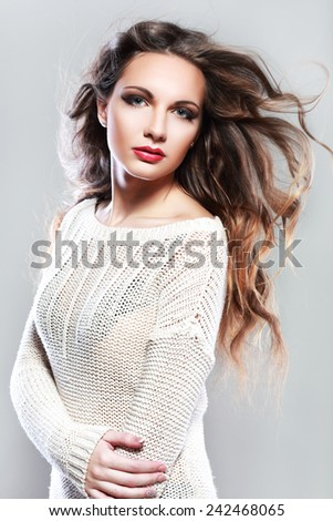 Portrait of a beautiful brunette girl with fluttering hair - stock photo