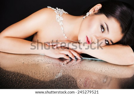 portrait of a beautiful brunette girl with luxury accessories. - stock photo