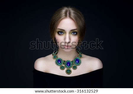 portrait of a beautiful brunette girl with luxury accessories - stock photo