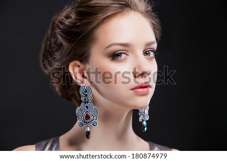 portrait of a beautiful brunette girl with luxury accessories.Beauty with jewelery.  - stock photo