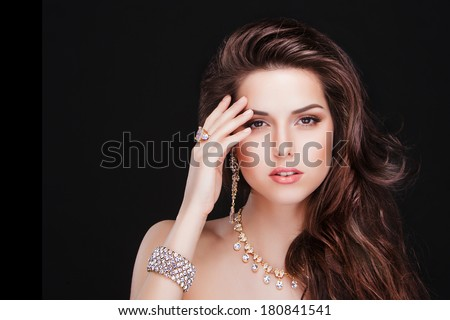 portrait of a beautiful brunette girl with luxury accessories.Beauty with jewellery. fashion model  - stock photo