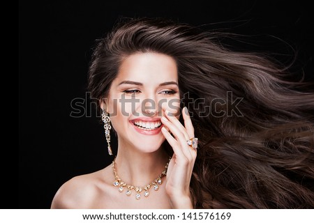 portrait of a beautiful brunette girl with luxury accessories.Beauty with jewellery. happy fashion model