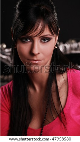 portrait of a beautiful brunette in pink - stock photo