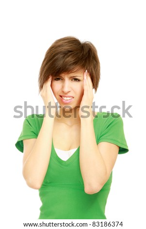 Portrait of a beautiful brunette with migraine - stock photo
