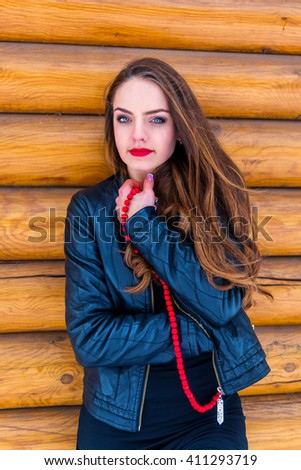 Portrait of a beautiful brunette with red bead - stock photo