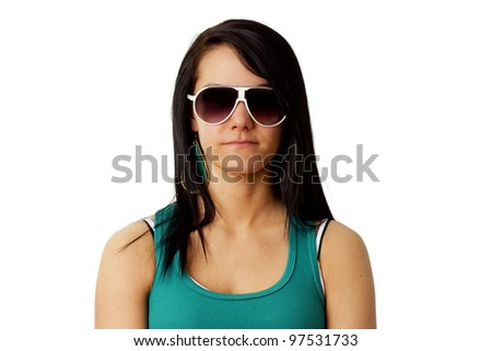 Portrait of a beautiful brunette with serious look hidden behind big sunglasses isolated on white background. - stock photo
