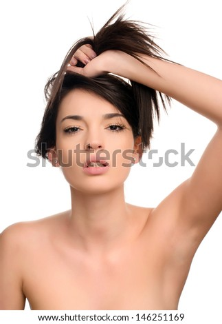 Portrait of a beautiful brunette woman keeping her long hair with her hand