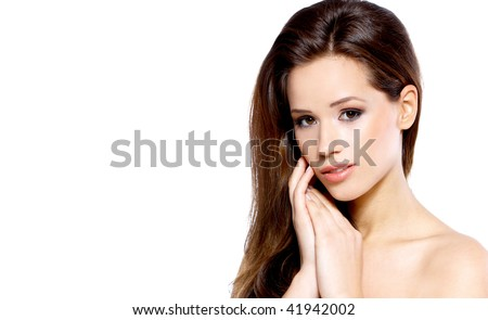 Portrait of a beautiful brunette woman on a white background