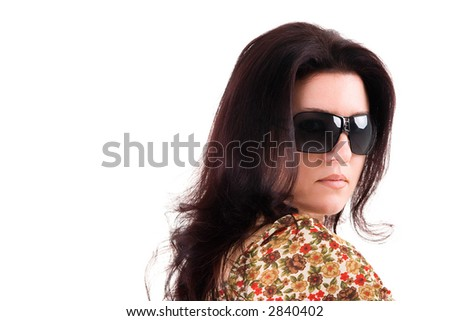 Portrait of a beautiful brunette woman wearing sunglasses, with copy space. - stock photo