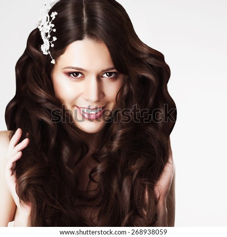 Portrait of a beautiful brunette woman with long hair in the studio, the concept of health and beauty - stock photo
