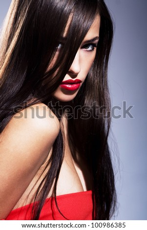 portrait of a beautiful brunette woman with red lips, focus on lips