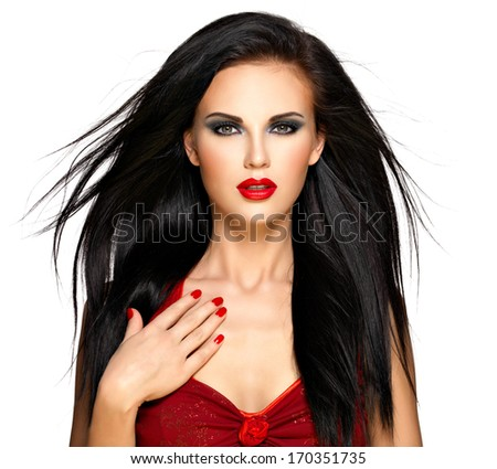 Portrait of a beautiful brunette woman with red nails and lips - isolated on white background - stock photo