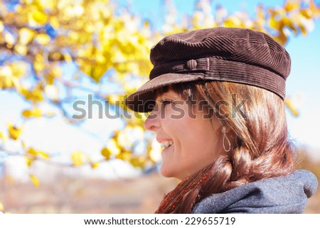 Portrait of a beautiful brunette young woman - stock photo
