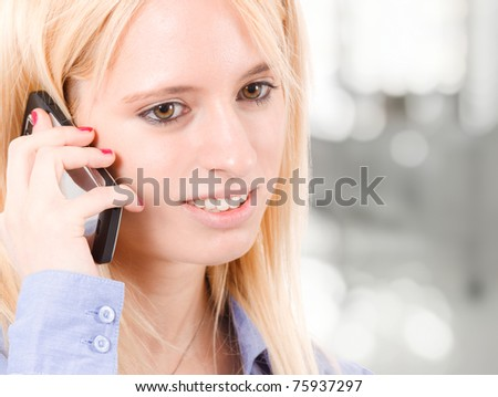 Portrait of a beautiful business woman at the mobile phone - stock photo