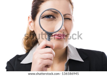 Portrait of a beautiful business woman holding a magnifying glass