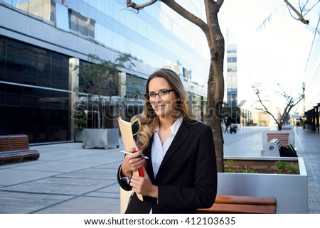 Portrait of a beautiful business woman outside her office. - stock photo