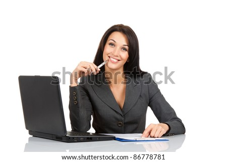 Portrait of a beautiful business woman sitting at the desk working over white background - stock photo