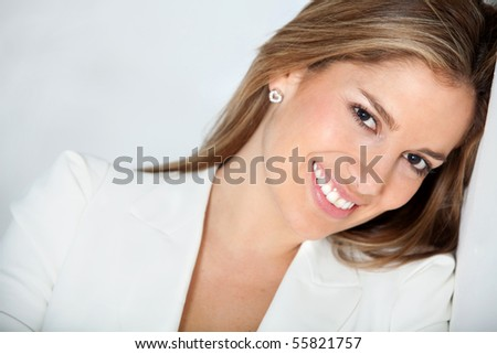 Portrait of a beautiful business woman smiling - stock photo