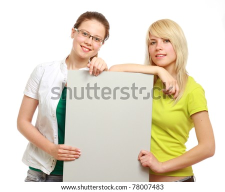 Portrait of a beautiful businesswoman holding a blank - stock photo