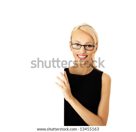 Portrait of a beautiful businesswoman holding a blank billboard, looking out from behind it. beautiful woman and blank sign - stock photo