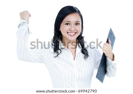 Portrait of a beautiful businesswoman holding clipboard and clenching her fist, isolated on white.