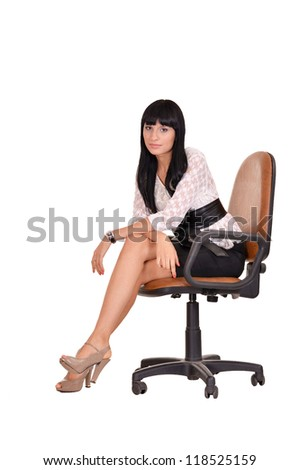 portrait of a beautiful businesswoman sitting on an office chair - stock photo