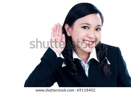 Portrait of a beautiful businesswoman with her hand on an ear, isolated on white.