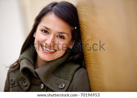 Portrait of a beautiful casual woman smiling - stock photo