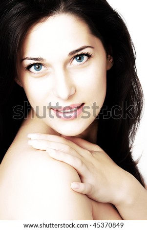 Portrait of a beautiful caucasian young woman with beautiful blue eyes - stock photo