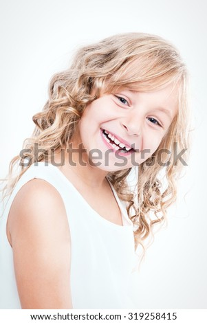 Portrait of a beautiful cheerful little girl. - stock photo