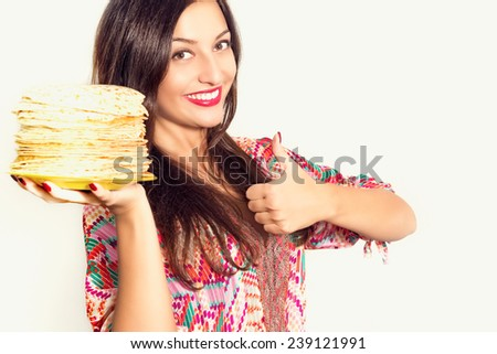Portrait of a beautiful cheerful young woman with pancakes - stock photo