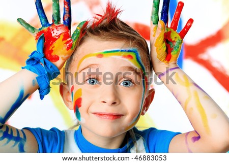 Portrait of a beautiful child enjoying his painting. Education. - stock photo