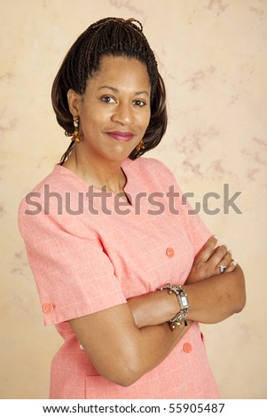 Portrait of a beautiful, confident businesswoman with her arms folded. - stock photo