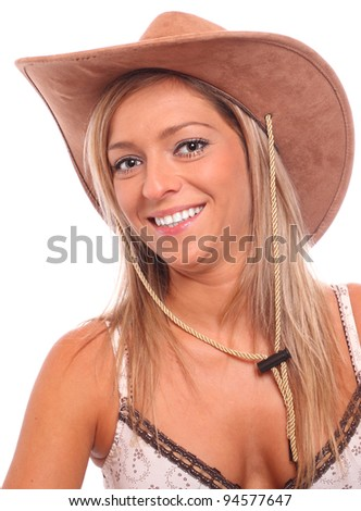 Portrait of a beautiful country girl with cowboy hat.
