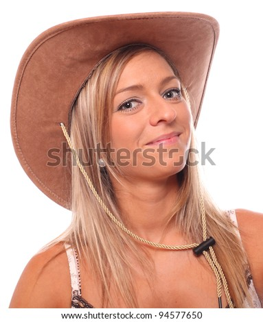 Portrait of a beautiful country girl with cowboy hat. - stock photo