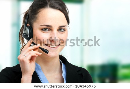 Portrait of a beautiful customer representative at work - stock photo