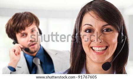 Portrait of a beautiful customer representative smiling - stock photo