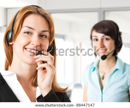 Portrait of a beautiful customer representative smiling in her office - stock photo
